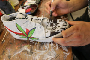 kid drawing on shoes