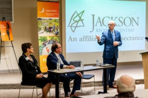 man speaking at Jackson Recovery Centers and Rosecrance affiliation event